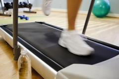 Woman Running on a Treadmill